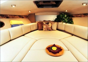 Shown with the cushions in place, a dinette berth becomes a large V-berth for sleeping or relaxing in the cabin. (Photo courtesy Chaparral Boats)