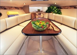 Without the berth cushions in place, a dinette berth functions as a dining table and seating area. (Photo courtesy Chaparral Boats)