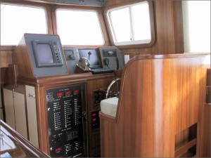 Traditional in layout, the pilothouse features state-of-the-art electronics.