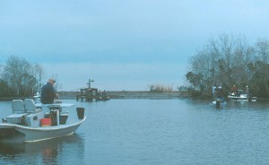 Boats crowd the end of a pipeline canal hunting reds and specks.