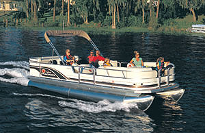 An entry gate is front and center on the boat, with long, straight settees flanking the port and starboard sides.