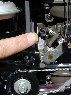 The finger of fate is pointed at the cap that seals the idle mixture screw on a Honda BF90 carb. Make this your last resort.
