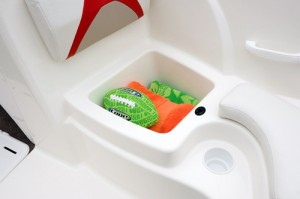 Bow seat cushions are secured with push-pin device, and the smooth, molded compartment can be used as a cooler.