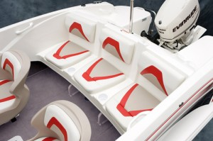 Individual rear-seat cushions are placed on a base molded as part of the fiberglass deck. Plastic braces below the seat are notched to double as a board rack.