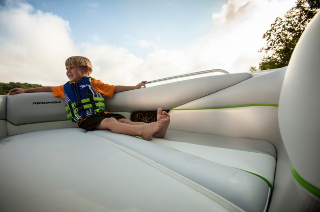 A photo of a child in the forward section of a Moomba Mojo 2.5.