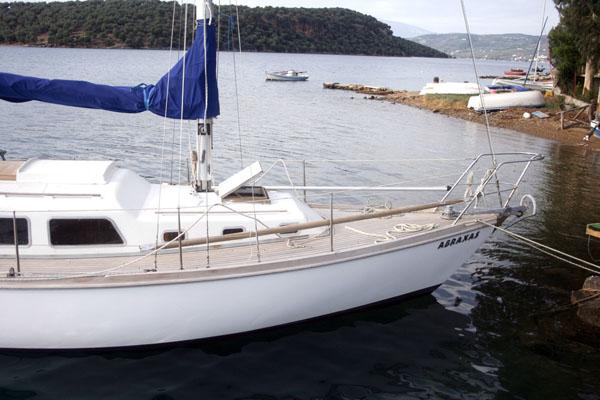 A photo of a teak-decked sailboat.
