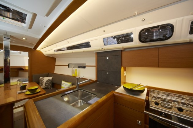 A photo of the main saloon and galley on the Jeanneau Sun Odyssey 349.