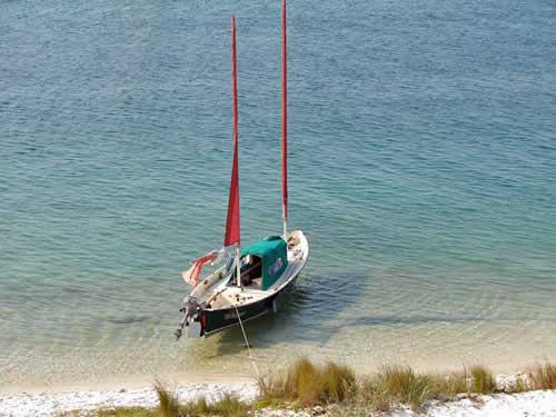 Sea Pearl at anchor off a beach
