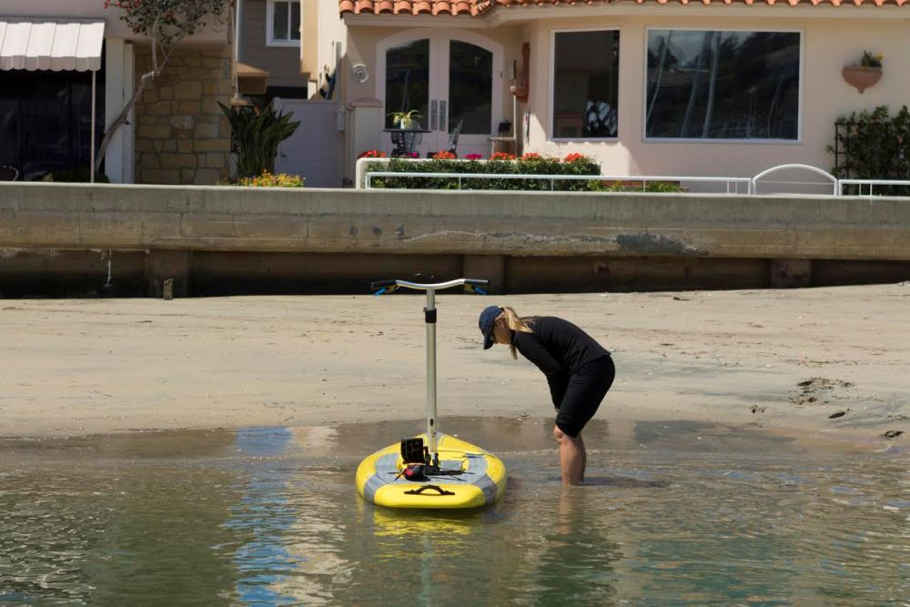 """Beaching this """"boat"""" is no problem. Nor is paddling it as if it were a traditional stand up paddleboard."""