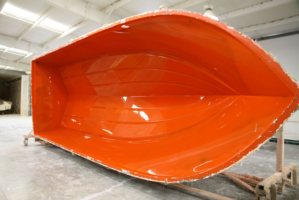 This female hull mold, from Parker Boats, is ready to be sprayed with gel coat and then laid up with fiberglass. A mold like this can be used to produce thousands of boat hulls.