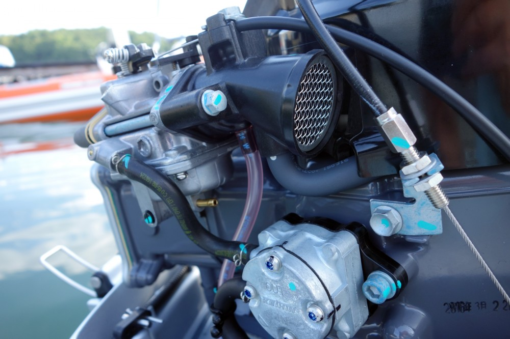 The fuel pump, filter (not visible) and carburetor are all easy to access. Attach a length of tubing to the small brass barb and back out a screw to neatly drain the float bowl for storage.