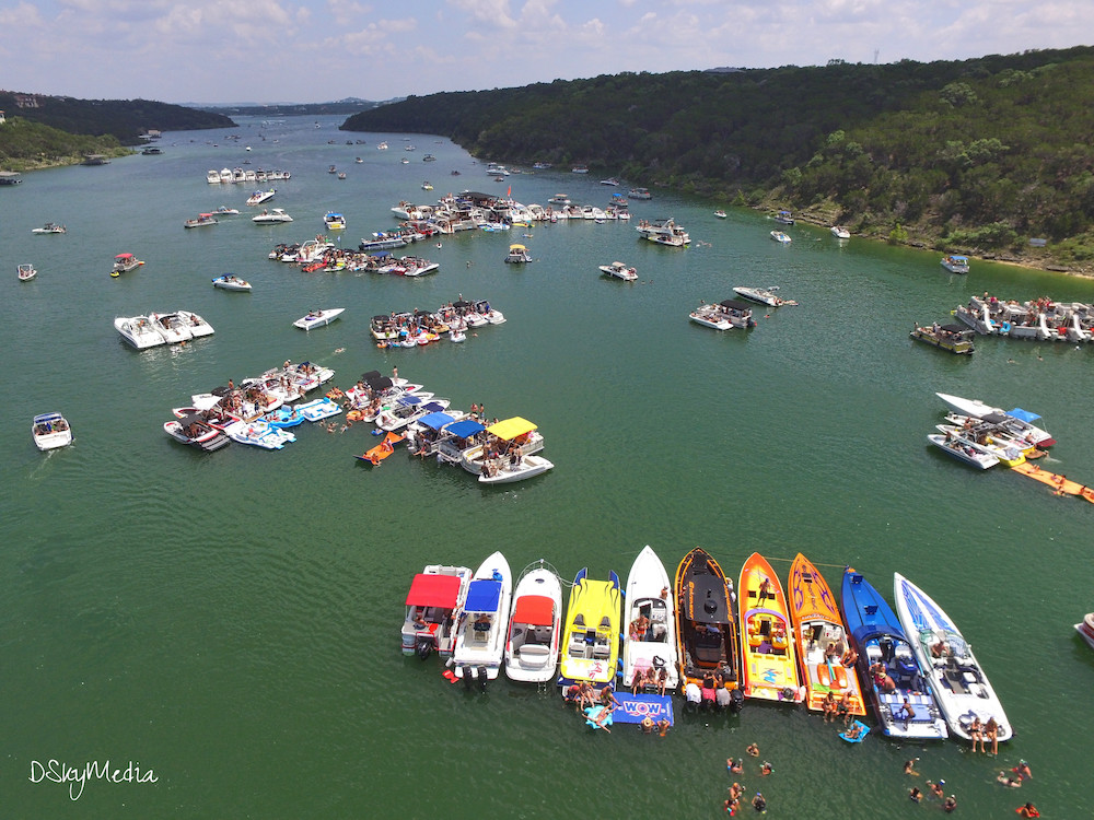 They say everything's bigger in Texas—and that includes the parties at Devil's Cove on Lake Travis. Photo Courtesy: DSkyMedia via Reddit.