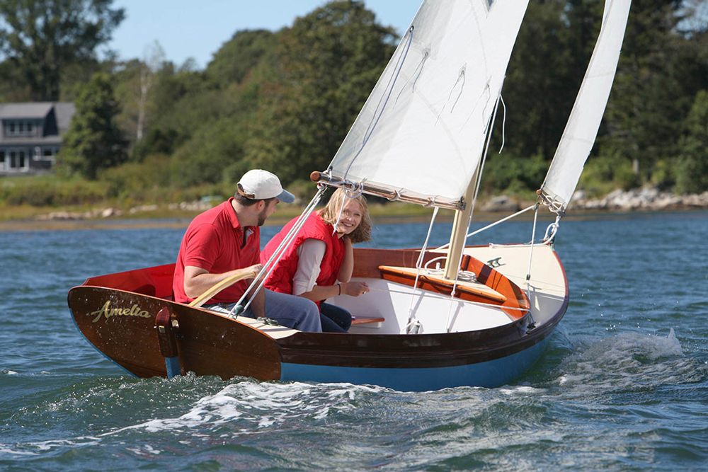 Sure, this daysailer doesn't have a cabin, and it is designed for short jaunts on the water. But there's a lot more to it than Wikipedia's description.