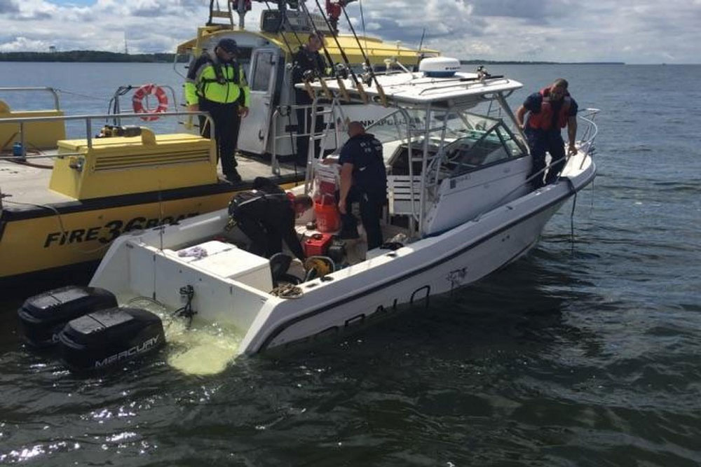 In some situations, transferring from one boat to another is a must. Here, members of the Annapolis Fire Department have boarded a small fishing boat to help de-water it. A second boat (from the Natural Resources Police) transferred the boat's captain and passengers onto their own vessel, and returned them to shore. Photo courtesy of USCG.