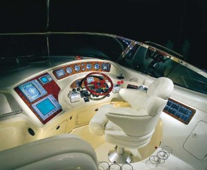 In addition to backlit instrumentation, the helm of the 510 Sundancer features Raytheon navigation equipment, a woodgrain steering wheel and hydraulic shift and throttle controls.