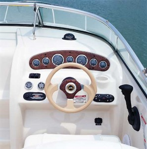 Gold-bezel gauges in a woodgrain panel at the helm are in clear view from the driver's seat with a flip-up bottom.