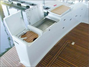 An entertainment center on the stern includes a gas grill and a hot- and cold-water sink.