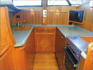 A range and oven are standard in the fully equipped galley.
