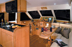 The galley area opens to the helm station.