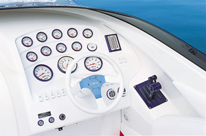 The helm station included a Dino tilt steering wheel, Gaffrig gauges in purple bezels including a liquid-filled, 100-mph Monster speedometer, and Gaffrig throttles and shifters.