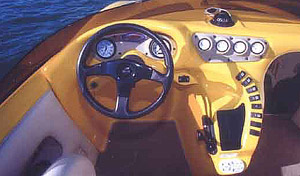 Molded helm highlights include a tilt steering wheel and Faria gauges.