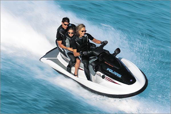 Though shown here with three riders, the clean-running Polaris Genesis FFI is a full-size four-up.