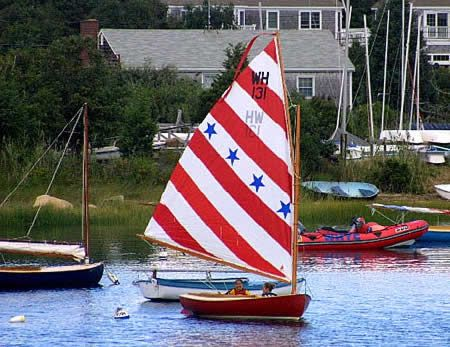 """1st Place"" casting off her mooring at Wild Harbor, North Falmouth. Launched June 2000. Photo by Roger Bowker."