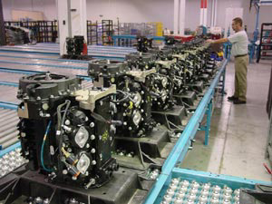 Outboard powerheads are assembled on a production line.