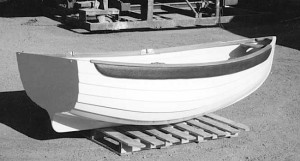 The Cherub, a 7-foot-4-inch fiberglass lapstrake rowing and sailing dinghy.