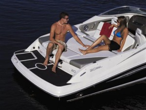 The bench seat on the Sea Ray 210 Select provides a great area to relax.