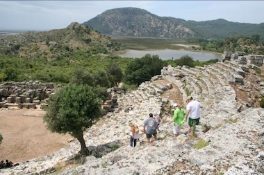 Cruises along the Dalyan River can include visits to Kaunos archaeological park and its amphitheater remains, as well as to the tombs of the Lycian empire, carved right into the mountainsides.