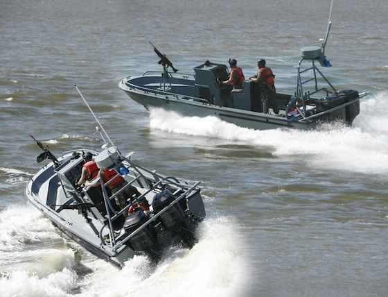 Ready for action, Mercury OptiMax JP outboards burn JP5 or JP8 jet fuel and power these TPSBs (Transportable Port Security Boats). Designed to fit in the cargo bay of a C-130 aircraft, the TPSB is based on a 25-foot Boston Whaler hull and is manufactured by Brunswich Commercial and Government Products in Edgewater, Fla.
