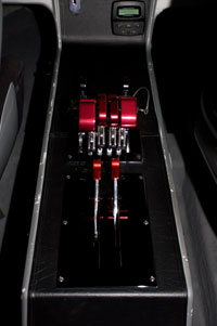 Custom-fabricated Latham Marine throttles and shifters are between the two forward seats.