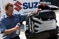 David Greenwood of Suzuki gives a rinsed powerhead a coat of Corrosion Block to protect it from salt-water nastiness.