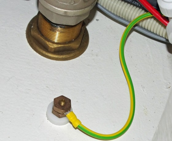 Trace this grounding wire back to the equipment it's attached to in order to find out what it's protecting.