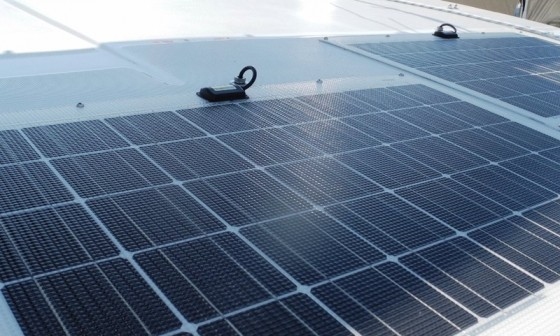"Solar panels are ""self-limiting,"" so as long as their cabling capacity exceeds the maximum possible amperage flow, no fuse is required by standards."