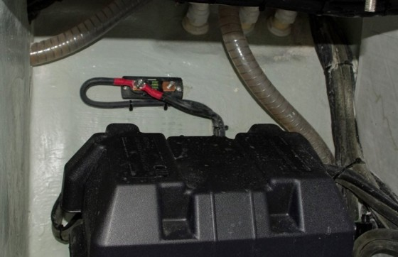 Chances are, this fuse blew when overloaded by the starter motor, and the crew simply put both cables on the same stud to complete the circuit and bypass the blown fuse.