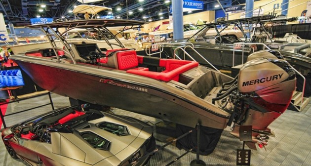 "Not to be outdone by the pure go-fast boat builders, Midnight Express showcased a dazzling 39-foot center console with an equally dazzling—and color-matched—Lamborghini. Photo by <A HREF=""http://naplesimage.com"">Jay Nichols/Naples Image.</A>"