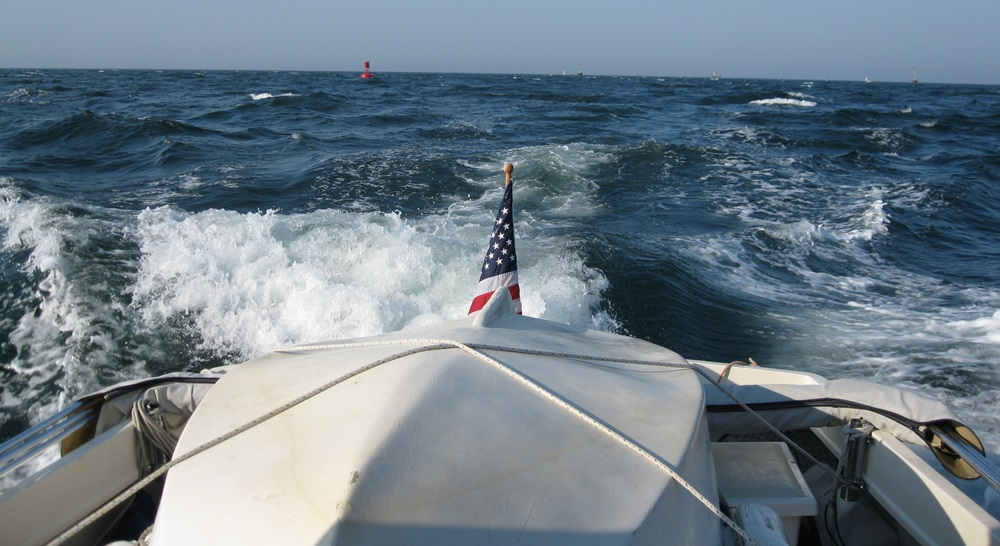For long passages or rough water we haul the dinghy aboard over a doormat and lash it down.