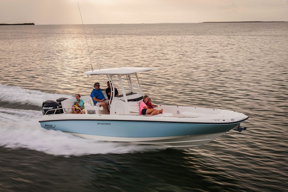 As you can see in this photo of a Boston Whaler 270 Dauntless, a modern planning powerboat rises up out of the water to a large degree, after exceeding displacement speeds.